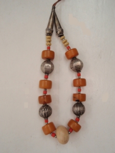 orange and silver necklace
