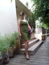 Green dress purple accesories