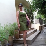 Green dress purple accesories