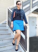 blue dress and black biker jacket