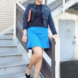 blue dress and black biker jacket