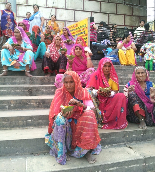 women with woven baskets waiting for the ceremony to begin